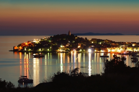 histories: Evening view of the city of Primosten in Croatia