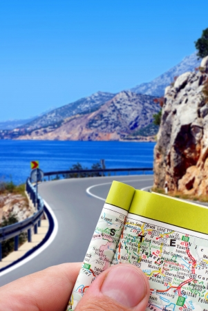 Driving down the road with a map in hand