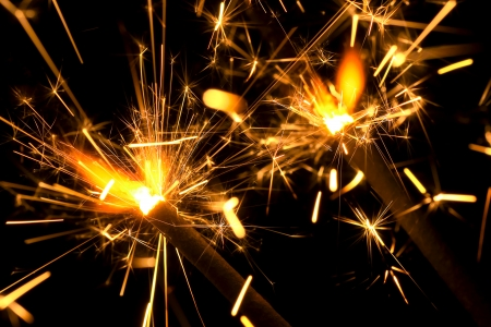 Two sizzling sparklers in the dark Stock Photo - 22889153