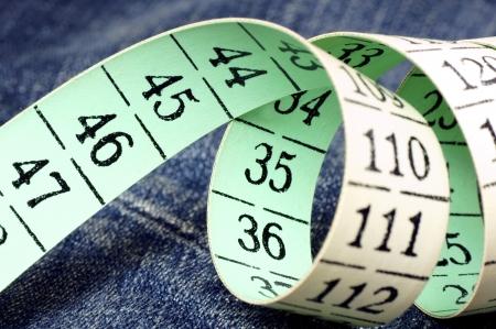 metre: Sartorial metre,lying on the jeans  Stock Photo
