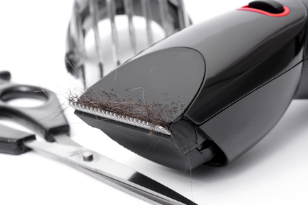 Electric hair clipper and scissors  photo