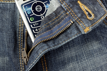faithlessness: Cell phone between open jeans