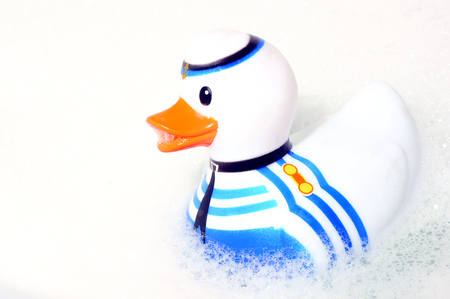 The plastic toy into the water in the shape of ducks  Stock Photo