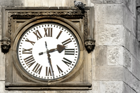 A stone wall with the old clock  Prague Astronomical Clock  photo