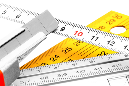 centimetres: Utility knife with different types of meters  Stock Photo