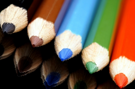 stationery needs: Colored pencils on a shiny surface