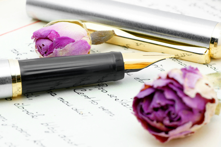 reminisce: Ink pen lying on the letter