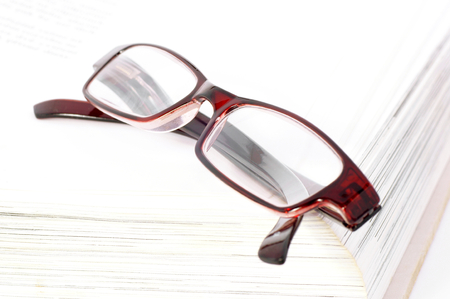 Glasses on the book  Stock Photo - 23984885