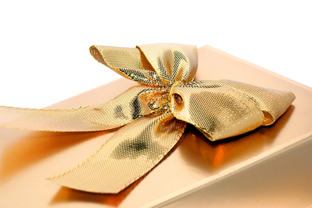 Gift of attention in gold color with a decorative ribbon