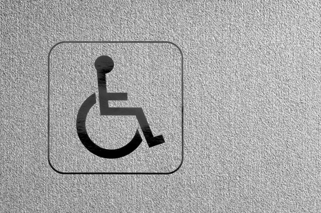 booked: Brand of physical disability on a silver surface  Stock Photo