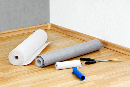 Wallpapers,roller and scissors lying on the floor