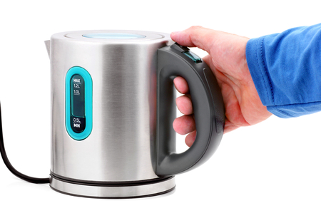 Hand holding an electric kettle on a white background