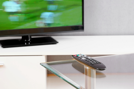 Television and remote control  Stock Photo