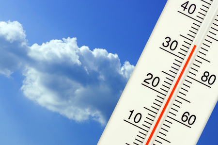 Tropical temperature of 34 degrees Celsius, measured on an outdoor thermometer  Stock Photo