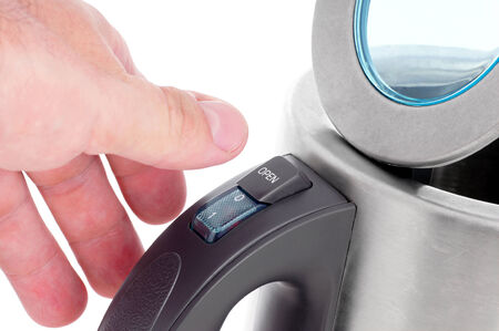 coking: Hand and open electric kettle. Stock Photo