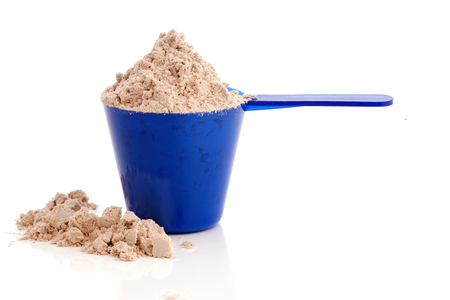 whey: Protein powder in the cup-supplement for athletes on a white background.