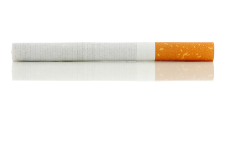 unhealthful: Cigarette lying on a shiny surface.