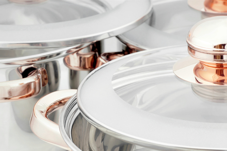 stainless steel range: Close-up on cooking pots made of stainless steel.