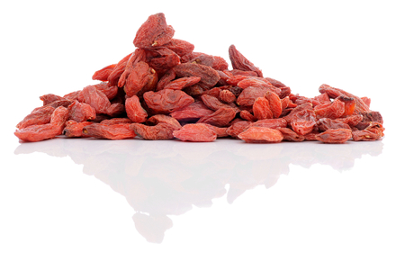 Goji berries (lycium chinese) reflection from the glossy surface. Stock Photo