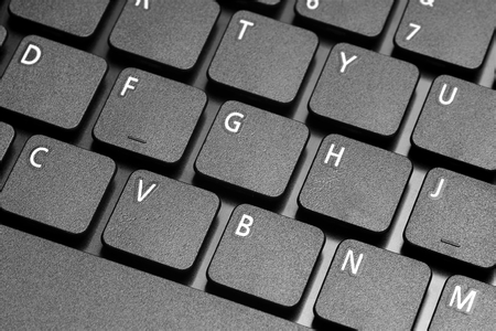 electronically: Close-up on the keyboard buttons laptop.