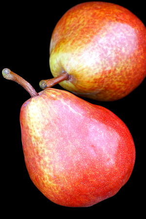 shoppe: Two pears side by side in a black background. Stock Photo