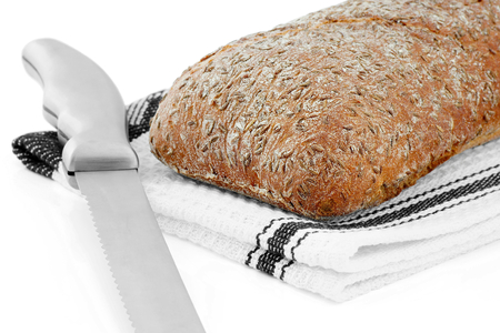 energetically: Caraway bread beside Which Lies knife.