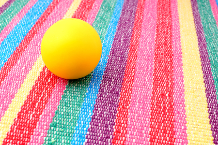 trundle: Foam ball for playing on colorful rug. Stock Photo