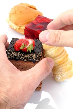 fat food: Hands that hold the chocolate cake.