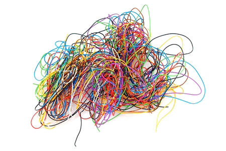 Lots of tangled electronic wires on a white background.. 版權商用圖片