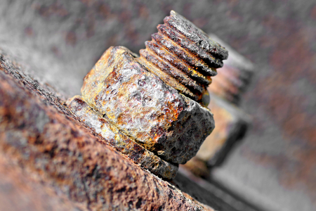 technically: Rusty bolt and nut in the old wooden sleepers. Stock Photo