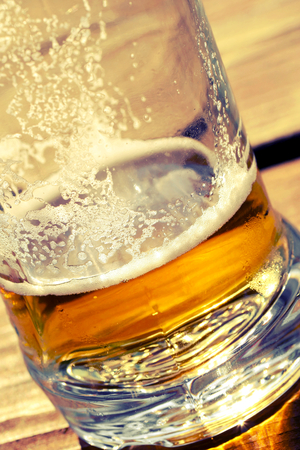 freshening: Close-us he been drinking beer in a glass on the table. Stock Photo