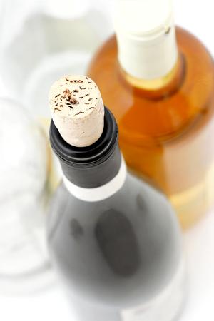 Open and full bottle of wine.