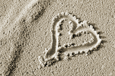 attentiveness: Heart drawn in the sand.
