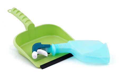 wastes: Chemical cleaner lying on the dustpan. Stock Photo