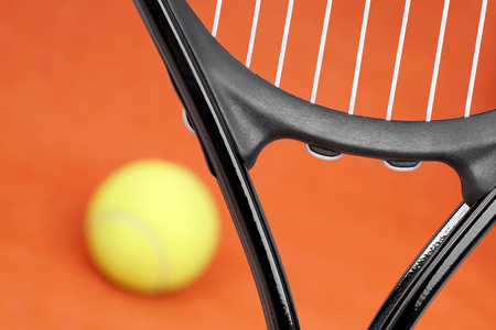 rapidity: Tennis racket on the court with the ball.
