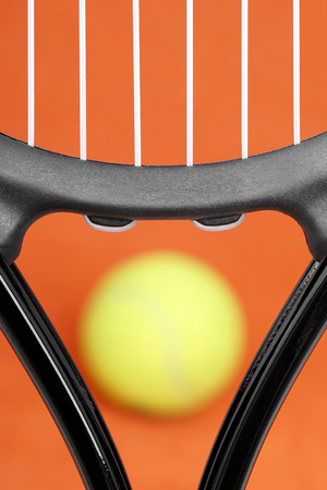 Tennis racket on the court with the ball.