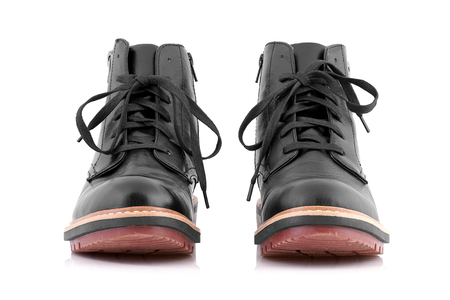 Black leather boots to cold weather on white background.