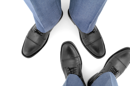 encounters: Feet in the shoes of two men facing Each Other. Stock Photo