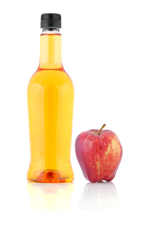 Apple cider vinegar in a bottle and apple isolated on white background. Stock Photo