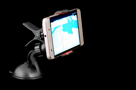Smart phone with navigation in car holder.