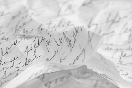 Torn and crumpled handwritten message