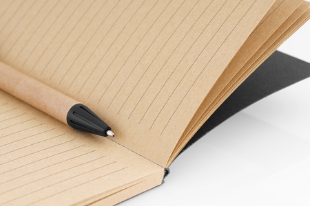 Writing pen with notepad.