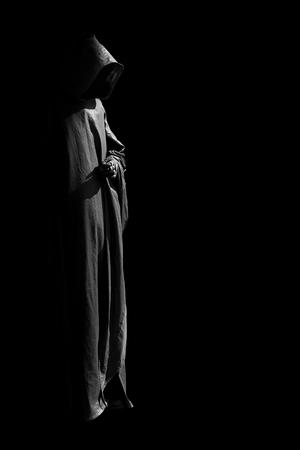 Person in black cloak.