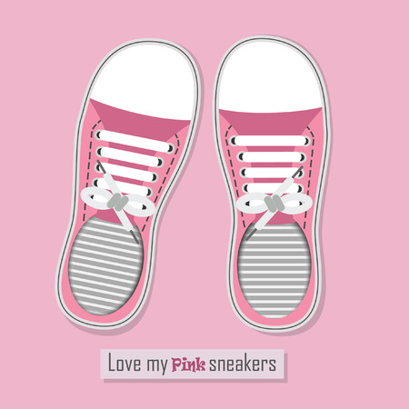 Love my pink sneakers - A pair of pink sneakers with shoelaces on pink background