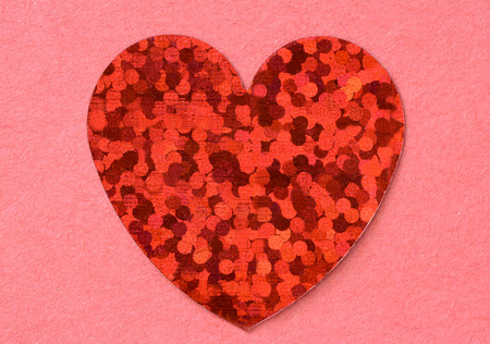 photo of object s: Red flat foil heart on pink paper background close up Stock Photo