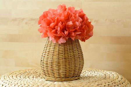 pom pom: Woven vase basket with red tissue paper flower pom pom