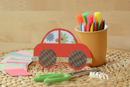 crafty: Cute crafty hand made red car for kids Stock Photo