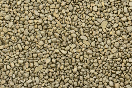 sprayed: Golden sprayed small natural gravels background Stock Photo