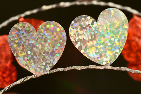 foil: Two white flat foil hearts on string close up Stock Photo