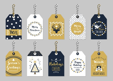 Golden and dark navy blue Christmas and Holiday gift tags set on gray background
